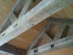 8 x 8 hand hewn beams create truss for outdoor patio