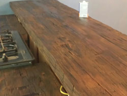 Kitchen counter tops made from hand hewn beams sawn 3 inches thick; old Butcher-shop