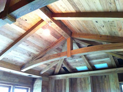 Chestnut paneling and arched beams for a library